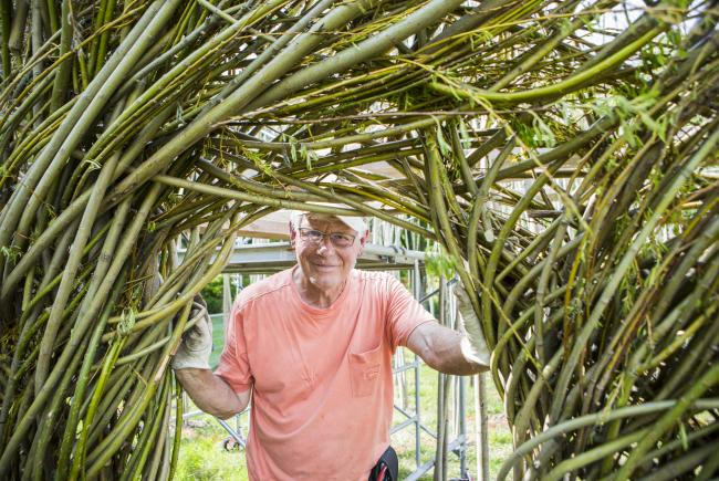 Mr. Patrick Dougherty, artist, before his work Celtic Knot