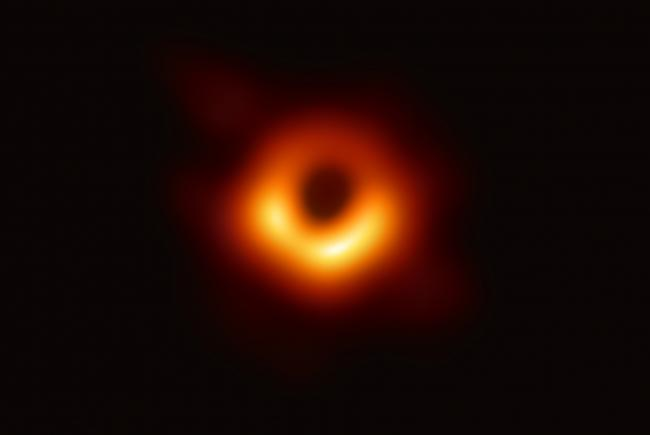 The black hole at the center of galaxy M87 and the ring of matter surrounding it.