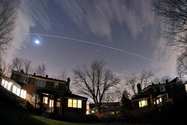 The International Space Station seen from Montreal. Automatic 5-second exposures created the dashed line effect.