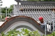 Renovations on the Chinese Garden – Summer 2017 - Tile setting on the roofs by Chinese workers.