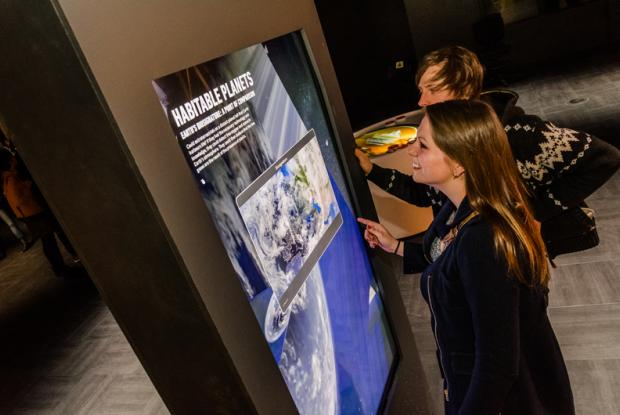 Visitors to the permanent exhibition at the Rio Tinto Alcan Planetarium