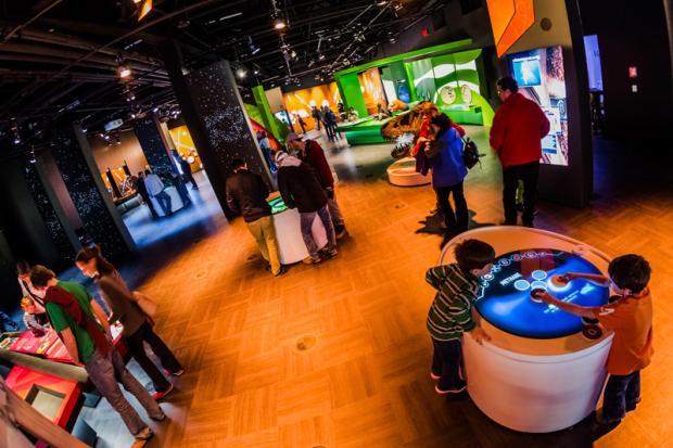 Visitors to the permanent exhibition at the Rio Tinto Alcan Planetarium