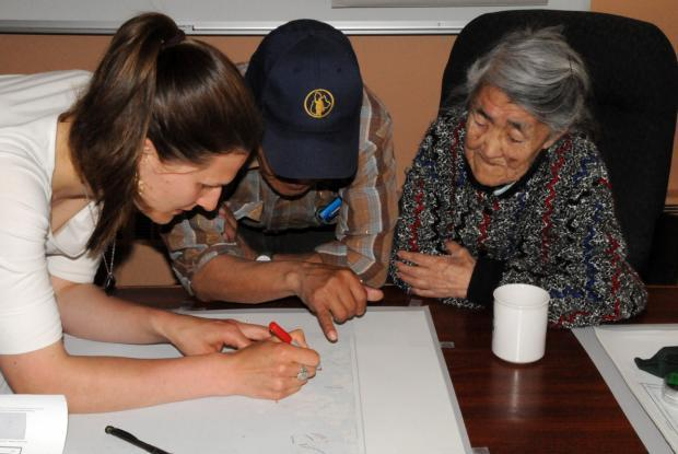 Interview about harvest sites with the help of a map of Nain, Nunatsiavut, Labrador